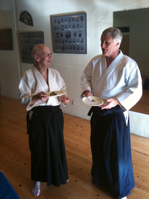 Bill and Bob Noha Sensei reminiscing over cheese cake